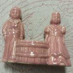 Vintage Pink Boy/Girl Planter.  Adorable with basket in middle for plant.  Pre-owned & in excellent condition.  $15.00 obo