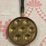 Antique Brass Egg Pan with Handle.  Cool piece.  Pre-owned & in excellent condition.  $20.00 obo
