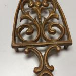 Antique Brass Iron Holder.  Very detailed and ornate.  Heavy.  Pre-owned & in excellent condition.  $18.00 obo