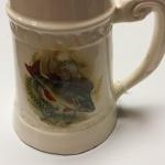 Vintage Porcelain Beer Stein with Fish.  Great detail in Fish picture on front.  Pre-owned & in excellent condition.  $20.00 obo
