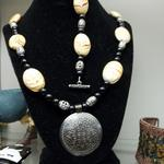 "African Tan Stone & Black Bead Necklace & Bracelet.  Necklace has beautiful detailed metal medallion.  Measures 24""l.  Bracelet measures 8""l.  Pre-owned & in excellent condition.  $60.00 for the set obo"