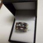 Sterling Silver Thick Band with Accents Ring.  This Ring is beautiful.  Size 8.  Pre-owned & in excellent condition.  $35.00 obo