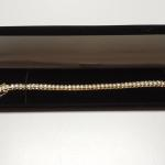 "Gold Overlay Sterling Silver with Cubic Zirconia Tennis Bracelet.  Gorgeous.  Has 2 safety latches on each side.  Measures 8"" in length.  Pre-owned & in excellent condition.  $89.00 obo"