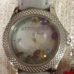 Attitude by Rene Watch.  Has multi Gemstones inside and a leather band.  Pre-owned & in excellent condition.  $75.00 obo