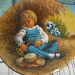 John McClelland - Collector Plate.  Plate 2 in Mother Goose Series:  Little Boy Blue 1980.  Comes with COA and Brochures.  This plate has a chip on the bottom of picture.  We are asking $8.00 obo