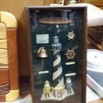 "Lighthouse Shadow Box.  Dark wood with different symbols including a lighthouse.  Measures 11""l x 3.25"" w x 21""h.  Pre-owned & in excellent condition.  $45.00 obo"