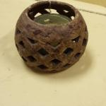 Thailand Ceramic Wholey Ball Candleholder.  Awesome when lit.  Pre-owned & in excellent condition.  $17.00 obo