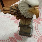 Resin Eagle Head on Pedestal.  Great piece.  Measures 10 x 14.  Pre-owned & in great condition, has a chip on bottom of pedestal.  $40.00 obo
