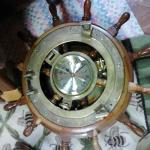"Ship's Clock in Ship's Wheel.  Great clock.  Measures 18"" in diameter.  Pre-owned & in excellent condition.  $120.00 obo"