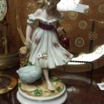 Vintage porcelain girl with goose figurine.  Gorgeous piece.  Pre-owned & in excellent condition.  $15.00 obo
