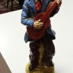 "Vintage Hand Painted Guitar Player Statute.  Gorgeous Statute.  Measures 12"" high.  Pre-owned & in excellent condition.  $22.00 obo"