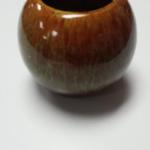 Small Ceramic Round Vase.  Beautifully painted and glazed green and brown.  Pre-owned & in excellent condition.  $16.00 obo
