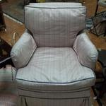 Vintage Pink Chair with Blue Trim on Wheels.  Has arm covers.  Pre-owned & in excellent condition.  We are asking $85.00 obo