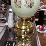 "Vintage Hurricane Lamp with Round Globe.  Picture shows Globe as white, but it actually a light green.  Measures 21"" high.  Pre-owned & in excellent condition.  $75.00 obo"