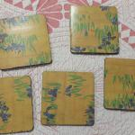 Decorative Wood Coaster.  Set of 5.  Pre-owned & in excellent condition.  $7.00 obo