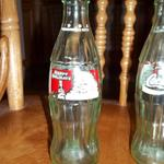 Coca Cola 1994 Limited Edition Happy Holidays Bottle - Lot of 2.  Each are 8 fl oz & empty.  Pre-owned & in great condition, no cracks or chips.  $2.00 each obo